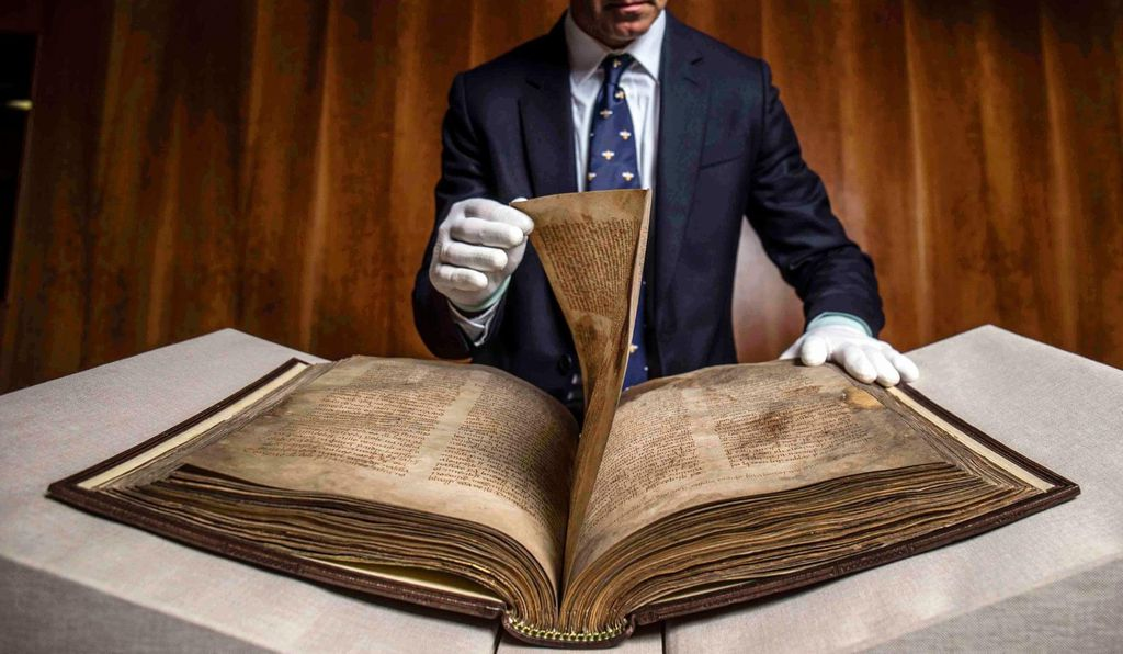 A curator handles the Book of Lismore. The historic tome will eventually be displayed in the Treasures Gallery at the University College Cork's Boole Library.