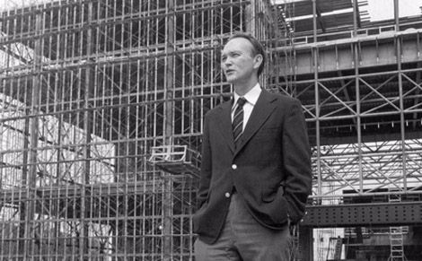 Michael Collins stands in front of the steel skeleton of the new National Air and Space Museum in July 1974