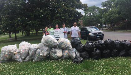 Volunteers pose with 28 bags of trash recovered from the River Terrace Park trash trap, Left to right: Ashley Cheung (Eco-Teen Action Network), Steve Kinzer (AWS Maintenance Engineer), Matthew Capuano-Rizzo (Eco-Teen Action Network), Zander (AWS Intern), James Foster (AWS President and CEO)