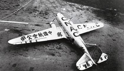 airplane with mismatched wings with Japanese characters on the wing and Roman letters on the body