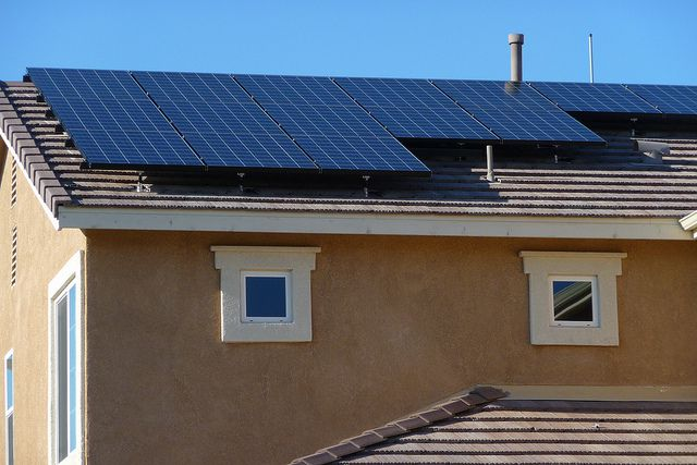 A house in Lancaster, California gets a solar power retrofit.
