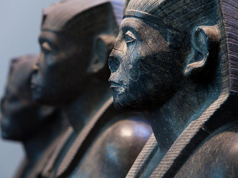 Three black granite statues of the pharaoh Senusret III, c. 1850 BC