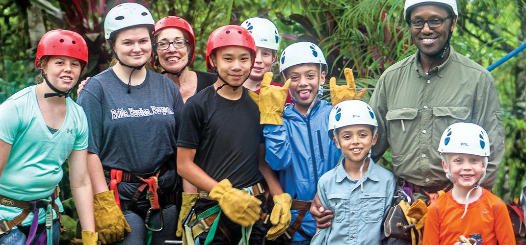 Kids and parents prepare for the rain forest zip line. Credit: Dennis Wille