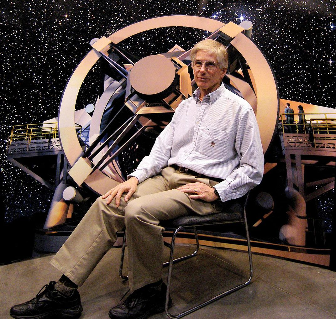 Tony Tyson with a model of the LSST telescope