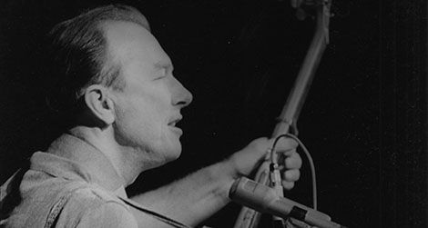 Pete Seeger performs at a peace rally in New York City, 1965.