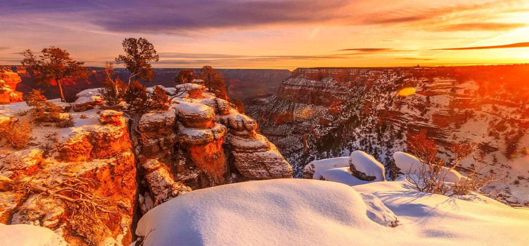 A blanket of snow covering the Grand Canyon