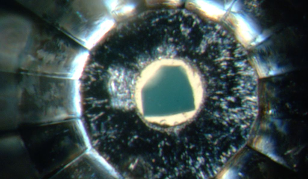 A bluish crystal of ringwoodite inside a diamond-anvil cell.