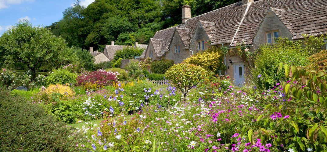Typical Cotswolds cottage and garden, Bibury
