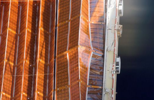 A balky solar array forces an extra spacewalk.