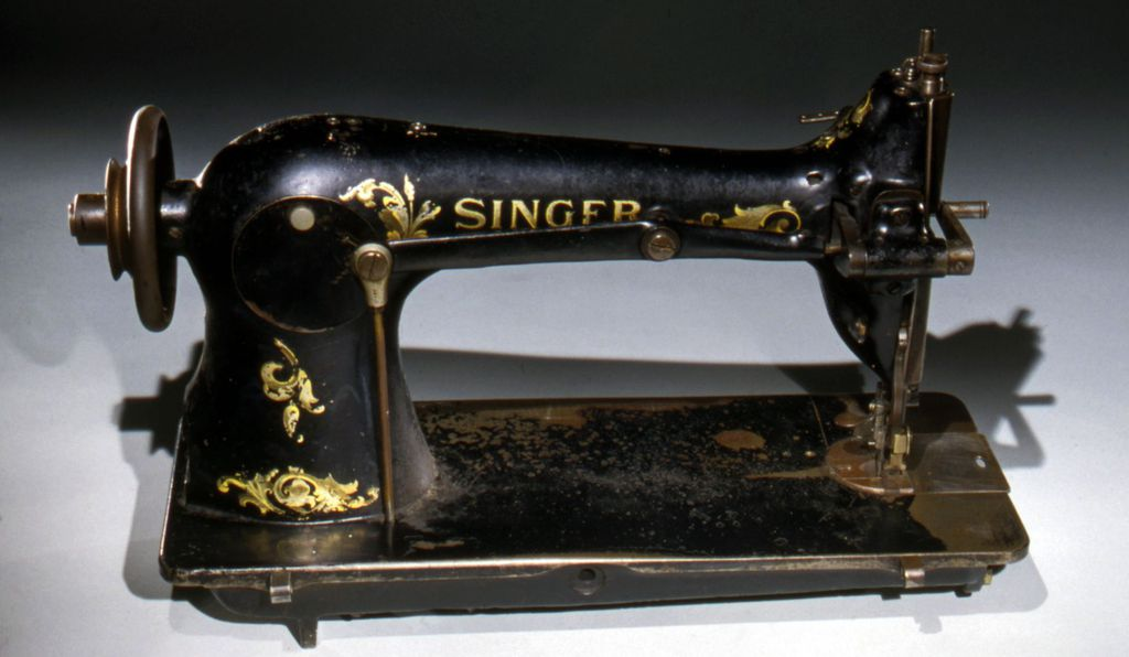 Triangle had modern well-maintained equipment, including hundreds of belt-driven sewing machines, like this Singer sewing machine from about 1920, mounted on long tables and run from floor-mounted shafts.