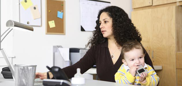 Woman at work with her child