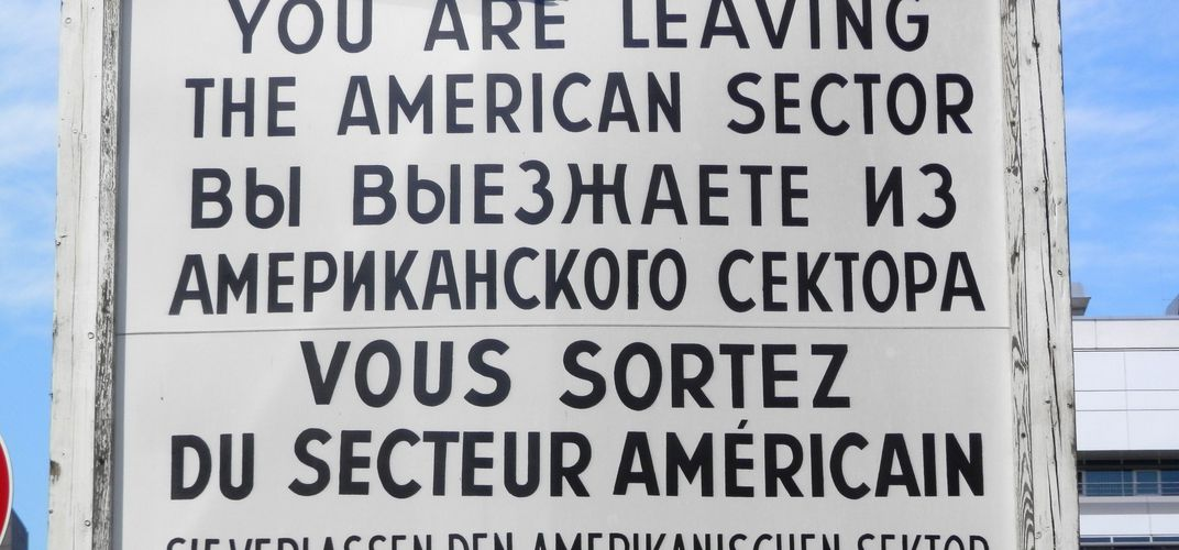 Sign in four languages at Checkpoint Charlie, Berlin