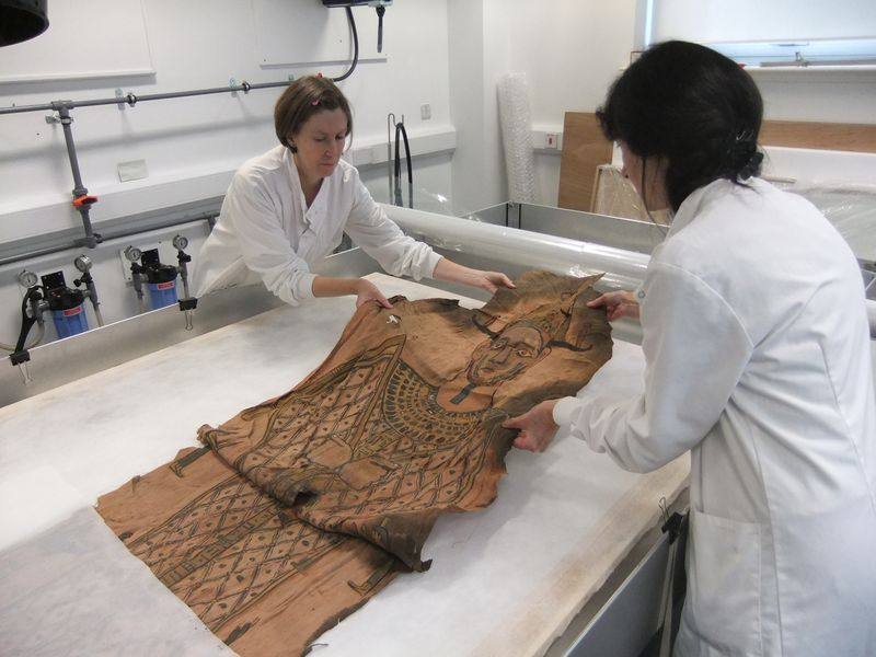 The shroud is unfolded. Copyright National Museums Scotland (1).JPG