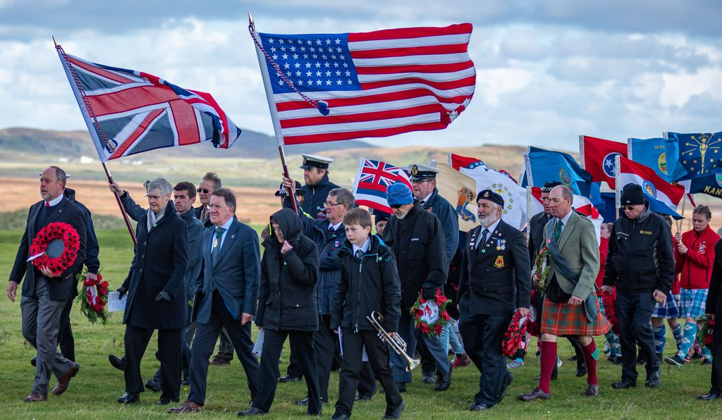 At the Kilchoman Military Cemetery, home to scores of graves of British crew and Americans who died in <em>Otranto's</em> sinking, we carried U.S. state flags made by Ileach students to represent the American soldiers.