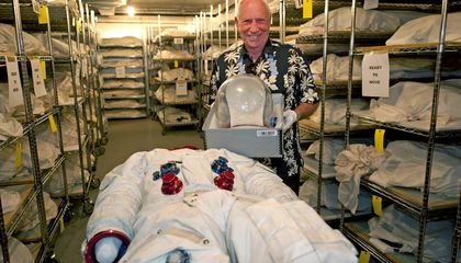 Al Worden visits his Apollo 15 spacesuit at the National Air and Space Museum.