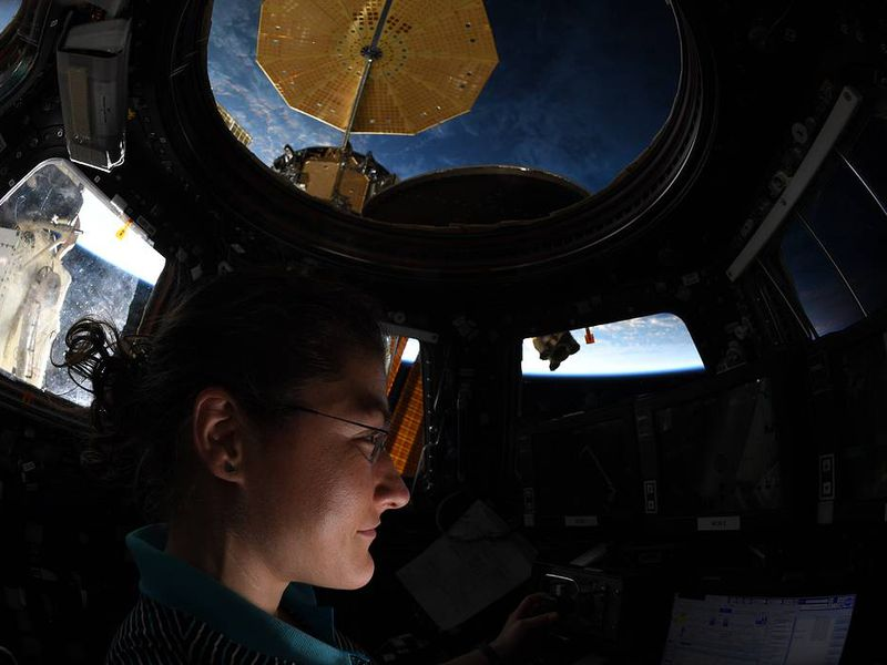 Koch makes observations from the International space Station's cupola