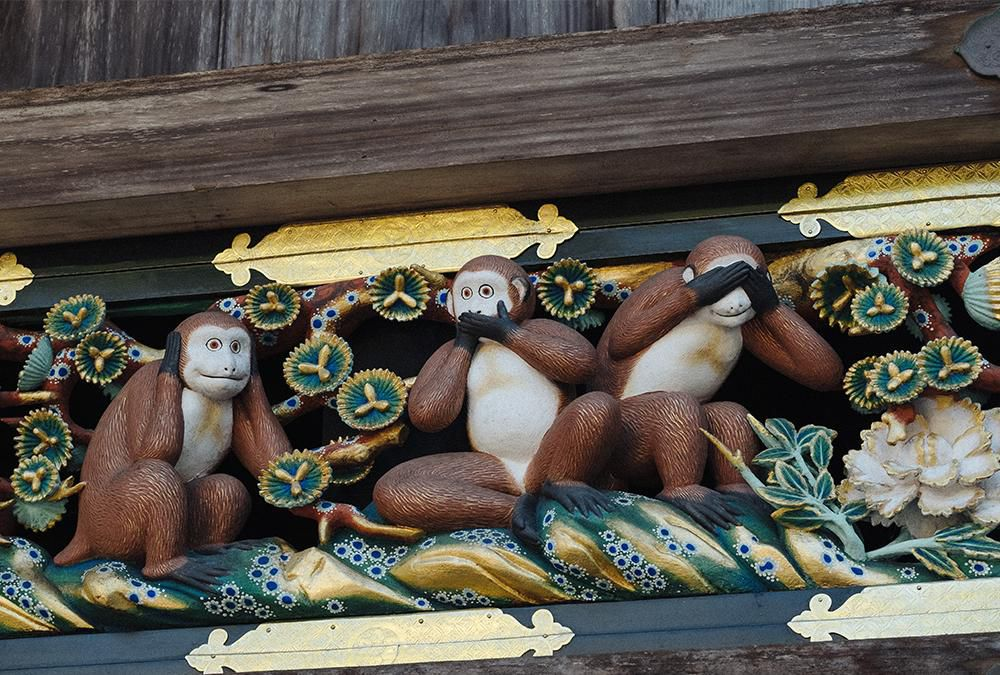 A carving of the Three Wise Monkeys on the sacred stable at the Nikko Toshogu Shrine complex