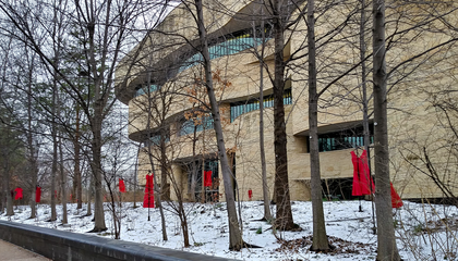 Red dresses displayed along the river walk of the National Museum of the American Indian in Washington, D.C., represent the crisis of missing or murdered Indigenous women and girls. Conceived by Canadian artist Jaime Black (Métis),