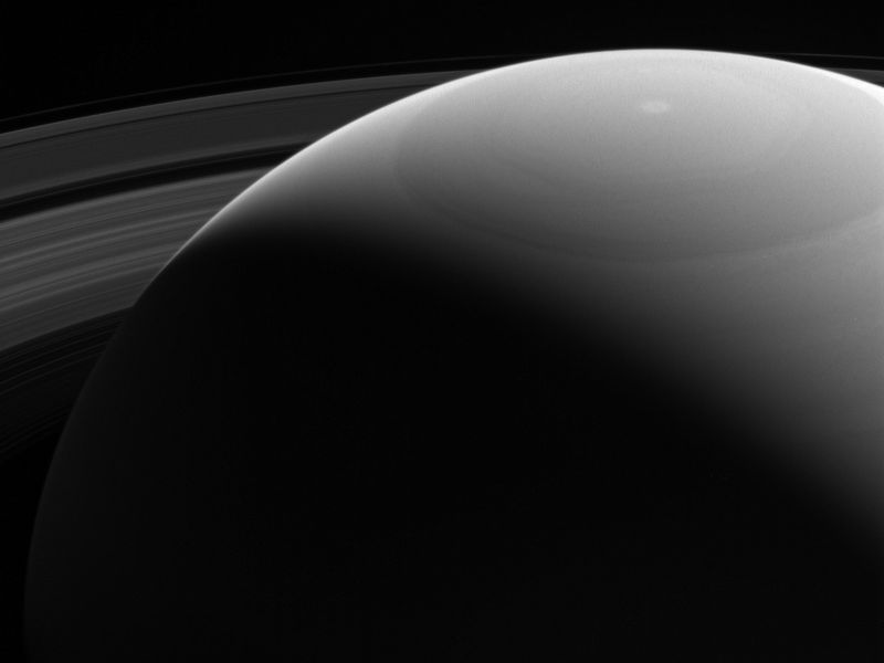 Peeking over saturn
