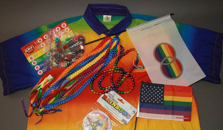 """Miscellaneous objects from the museum's collection that feature rainbows, including """"That's So Gay!"""" trivia game, coasters, and flags promoting marriage equality and immigration equality (NMAH)"""