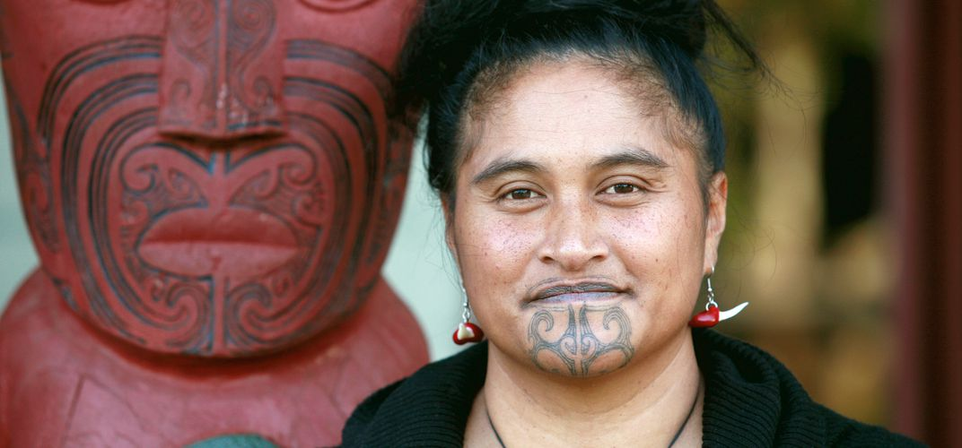 Young Maori woman with traditional Moko tattoos. Credit: James Heremaia/Tourism New Zealand