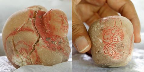 The carved alabaster vessel (shown from two sides) found in the burial chamber.