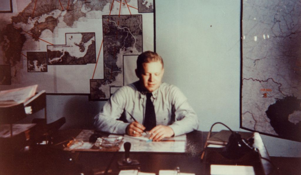 This color image shows Lieutenant Robert H. Myers at work in the room.