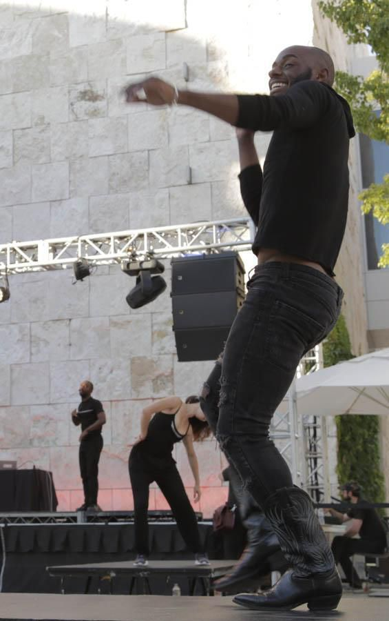 A man dancing on a stage.