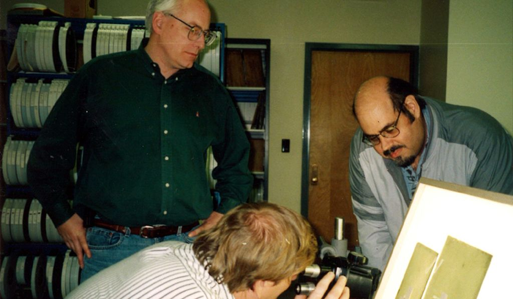 Michael DiMario (left), Greg Buchwald, and Walter Wild examine plates at the Yerkes Observatory.