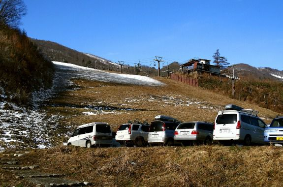 A chairlift hangs limp over a Japanese ski slope almost void of snow in December 2006.