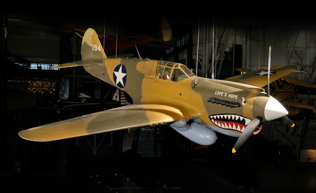 a Curtiss P-40E wears a shark face but was not a Flying Tiger