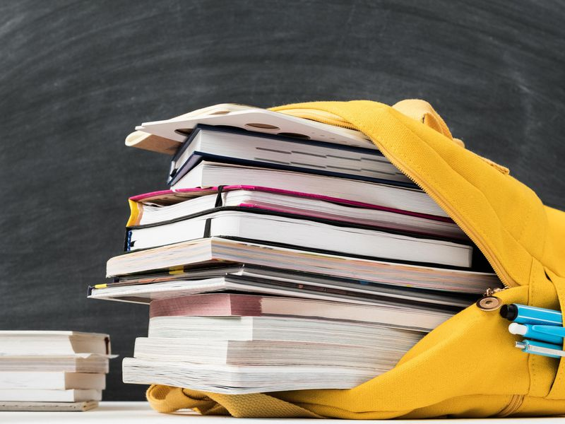 yellow backpack stuffed with books