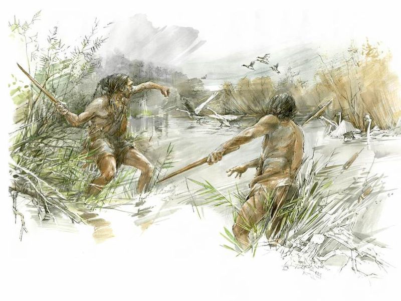 Two early hominins hunting with throwing sticks