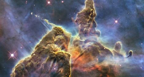 A budding star spits out jets of superheated gas and dust in the Carina Nebula