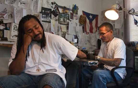 Q Monts sits patiently at Nu Flava Ink