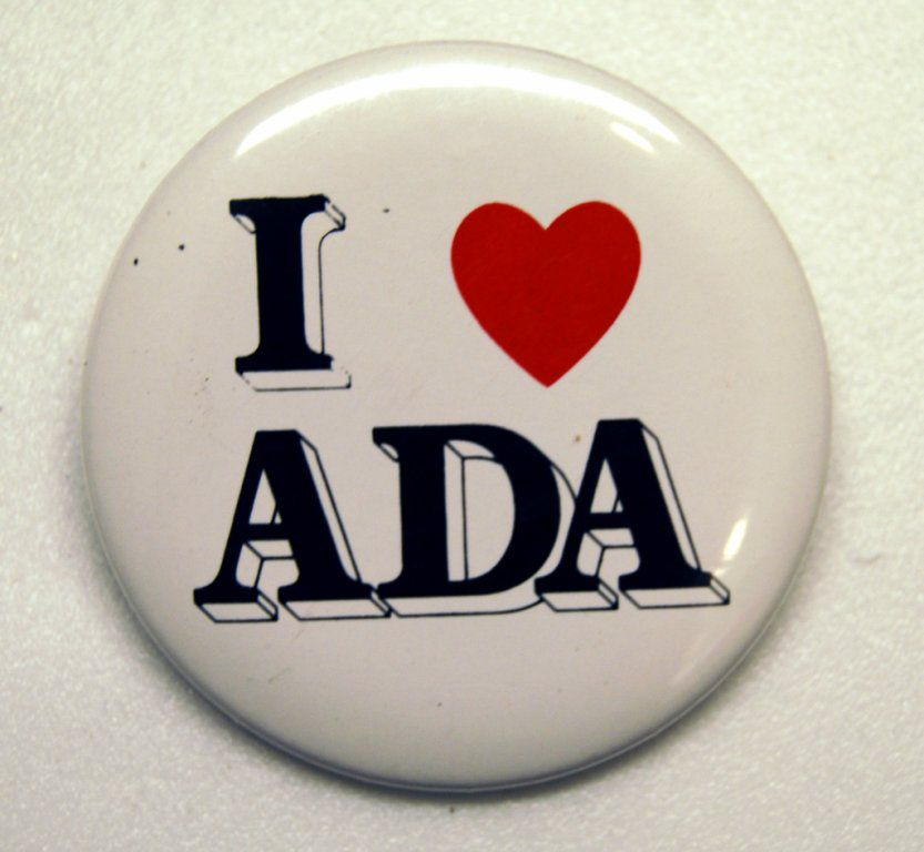 "A white button with black text that reads, ""I [red heart symbol] the ADA."""