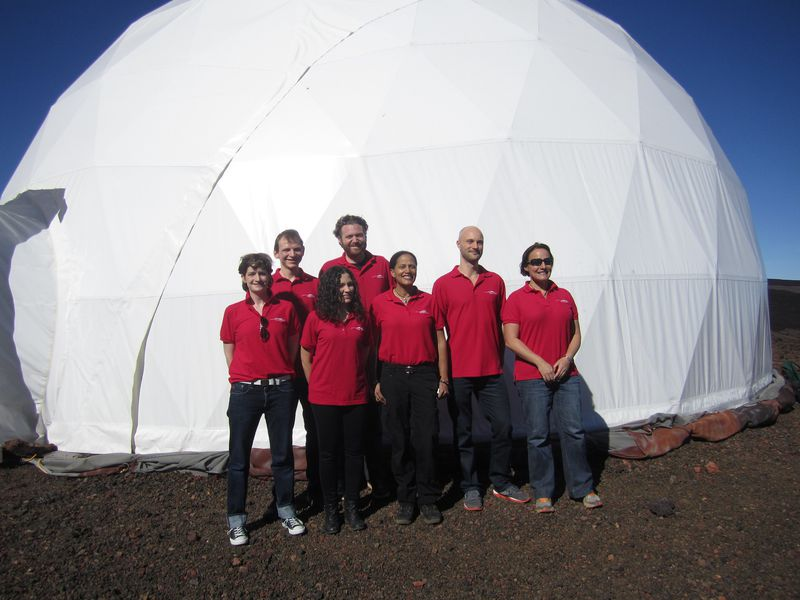 people in red polos outside a HI-SEAS habitat