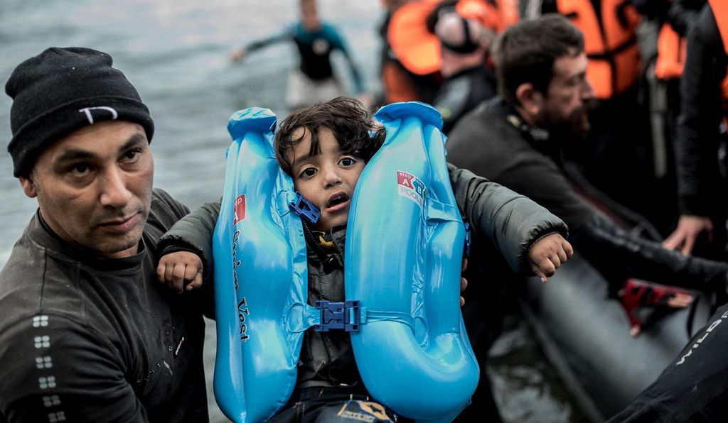 Refugees arrive on the beaches of Skala Sikaminias in Lesvos, Greece.