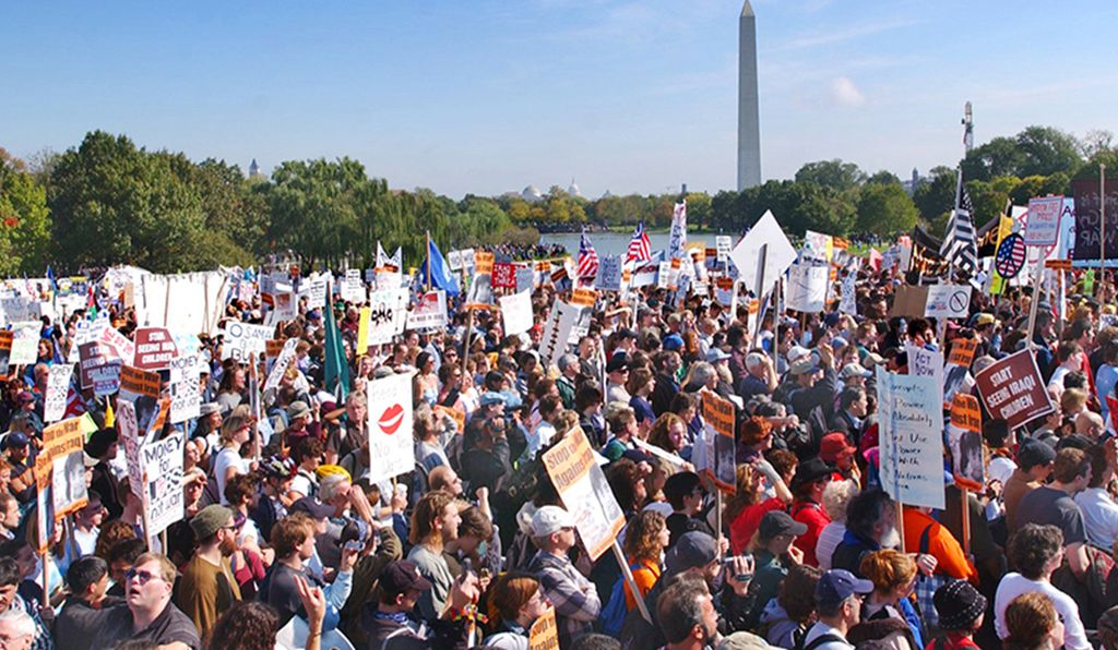 Demonstrators by the thousands gathered near the Vietnam Veterans Memorial in Washington Saturday, Oct. 26, 2002, as organizers marched against President Bush's policy toward Iraq.