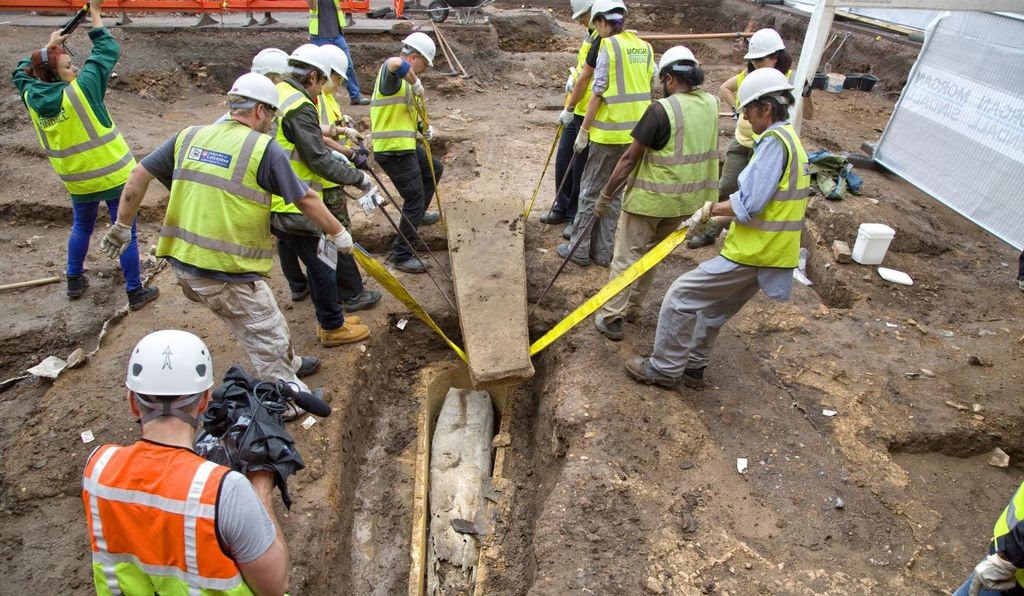 In this image, archaeologists open the stone coffin at the Greyfriars archaeological dig July 2013.