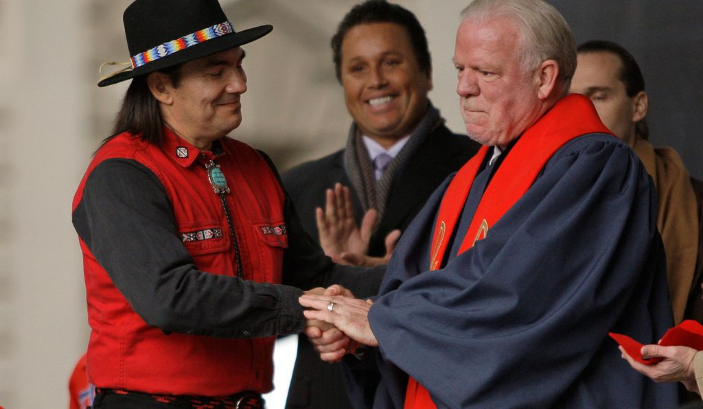 Curtis Zunigha, left, and Charles Morris, right, shake hands after an exchange of symbolic gifts during a healing ceremony involving the Lenape Native Americans and the Collegiate Church in 2009.