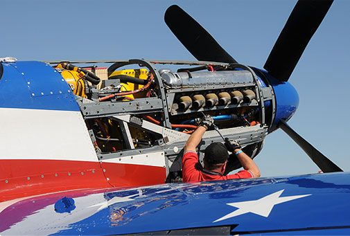 In the pits, crews work on systems and engines right up to the last minute. Miss America's powerplant is a Packard-built Rolls Royce Merlin V-1650-7, modified to put out 3,000-horsepower.