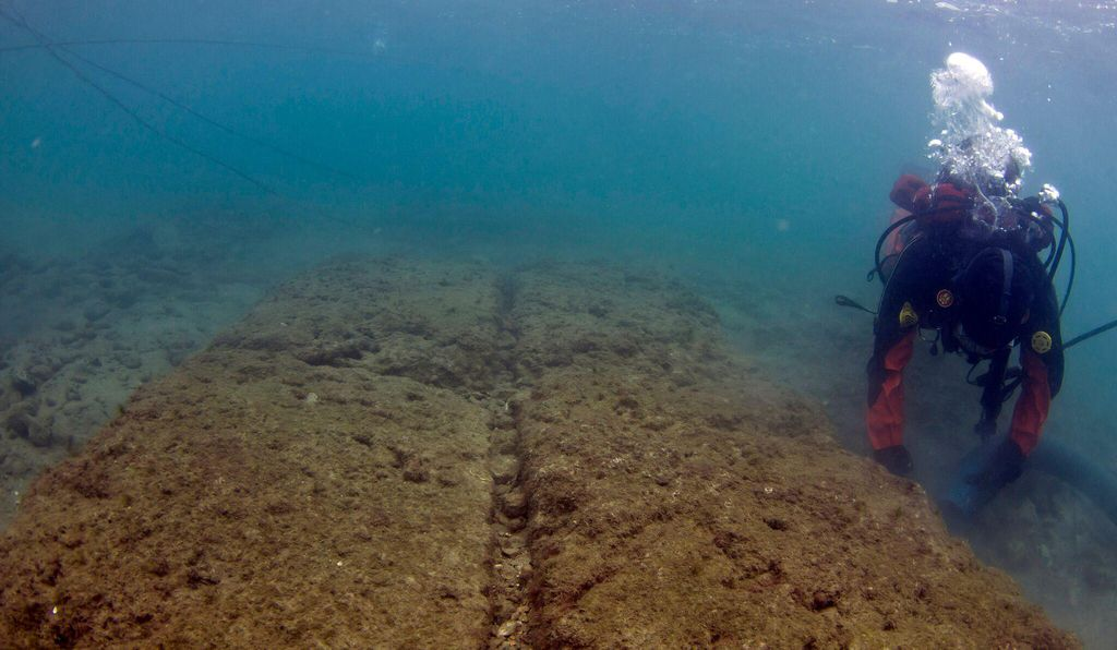 Diver excavating ship shed remains in Mounichia harbor