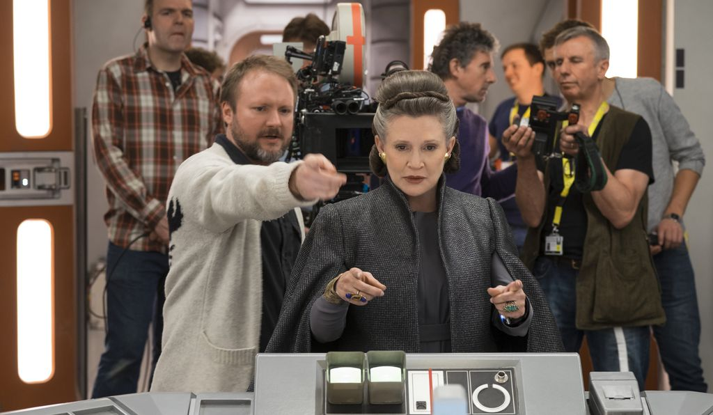 General Leia Organa (Carrie Fisher), center, spends several serene minutes in the vacuum of space following the destruction of her ship's bridge.