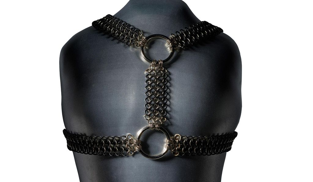 A metal harness, donated by a gay man from San Francisco. The donor also sent over a leather version, but Ott says she liked the texture and sheen of the metal.