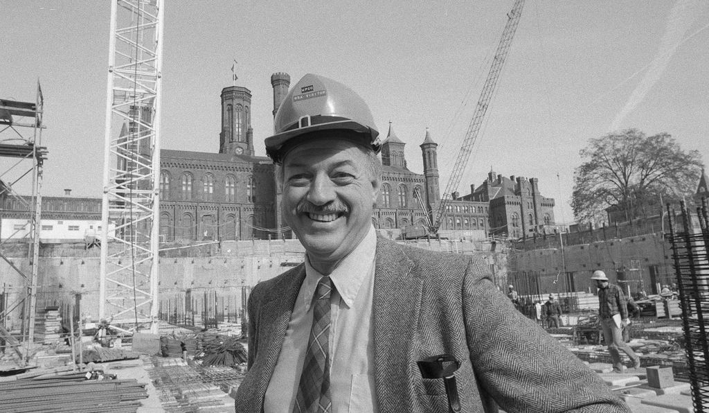 Secretary Adams on the site of the Smithsonian Quadrangle's construction. The Quadrangle helped to foster the sort of united communal atmosphere Adams felt was integral to the success of the Institution.
