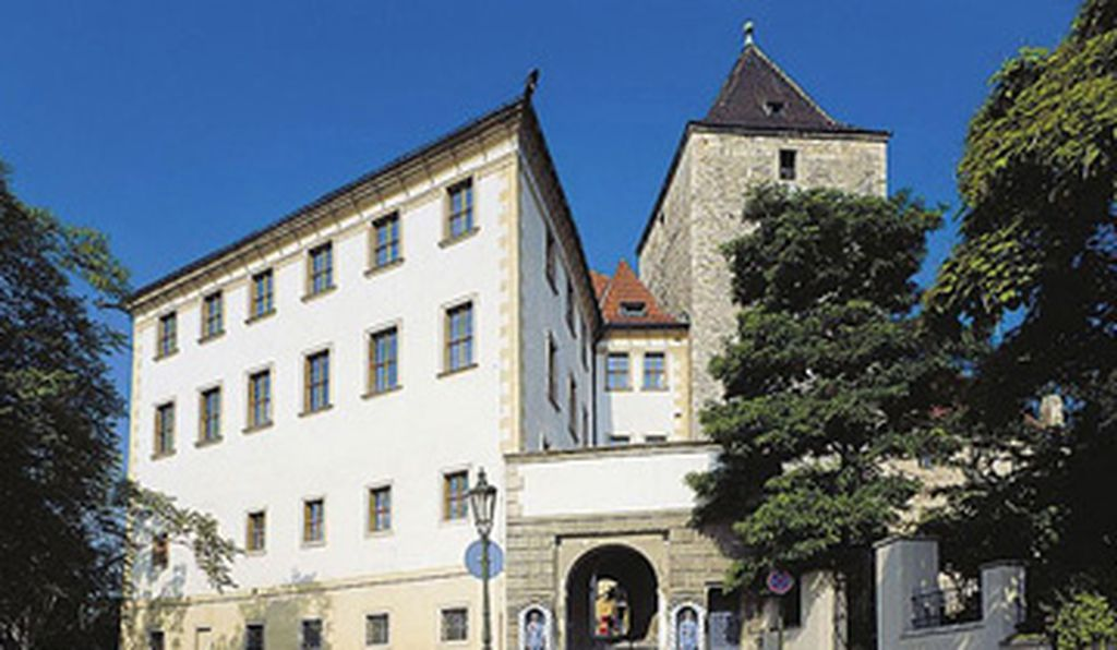 The Lobkowicz Palace stands behind the main entrance to the Prague castle.