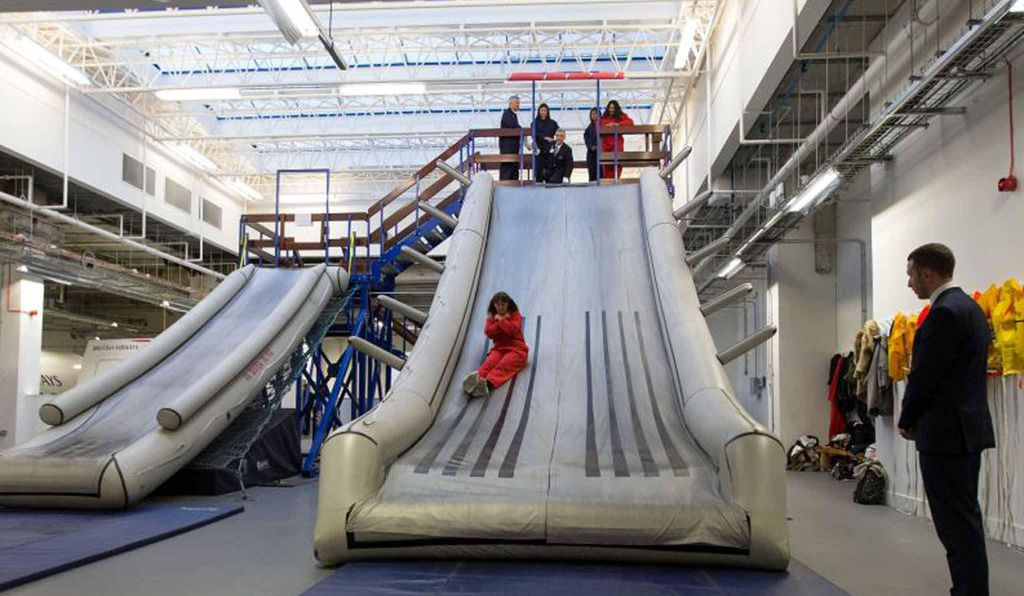 A British Airways cabin crew hones its evacuation slide technique at the airline's Heathrow training facility.