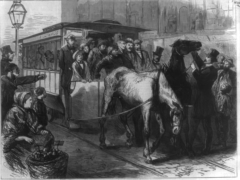 Man in top hat touching horse pulling a streetcar, as a tired horse droops its head