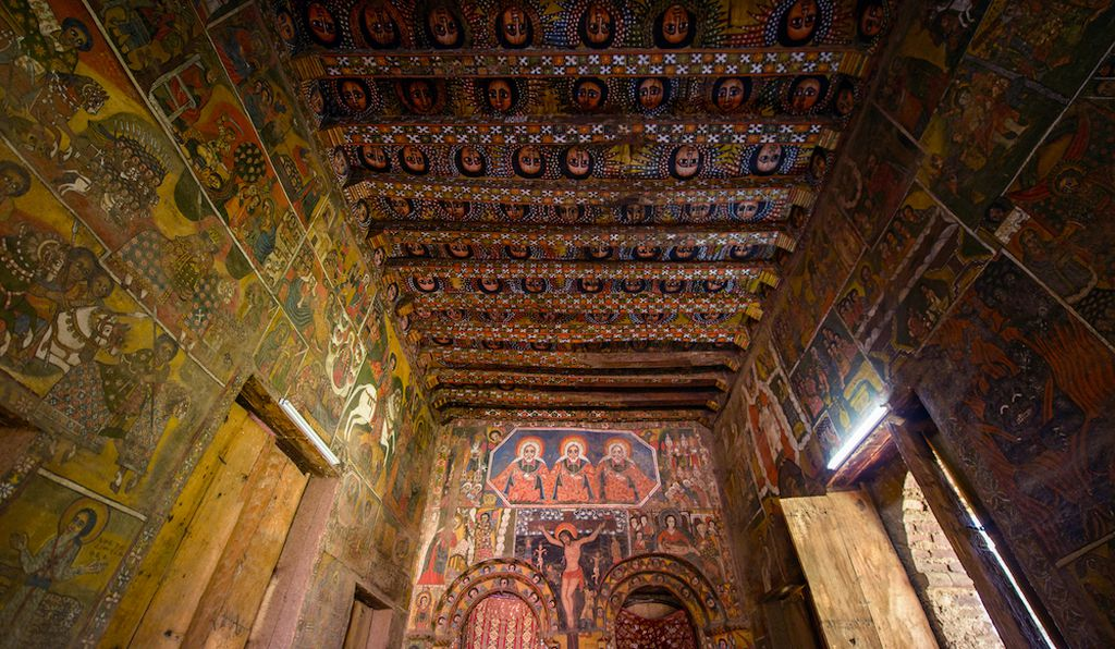 Debre Berhan Selassie Church, Ethiopia. The central image of the crucifixion, above which is an image of three bearded men symbolizing the Holy Trinity.